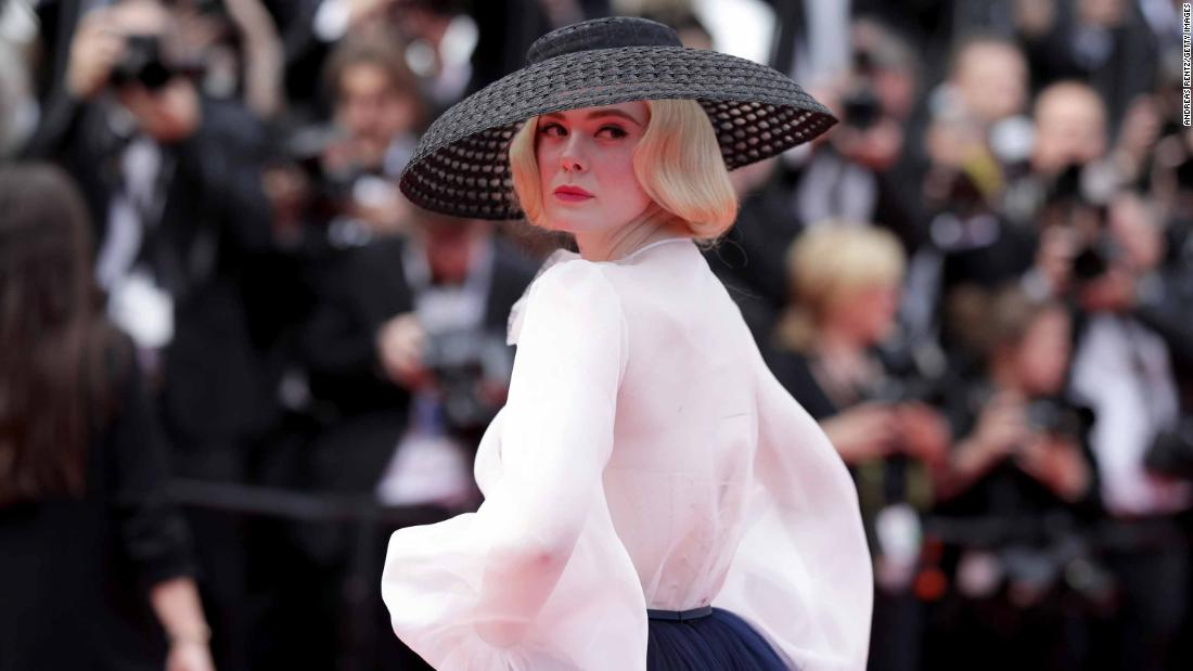 "Elle Fanning's takes a retro turn in Dior. The tulle skirt and silk organza shirt took 450 hours to create, the brand revealed on <a href=""https://www.instagram.com/p/Bxwltz2Igc9/"" target=""_blank"">Instagram</a>."