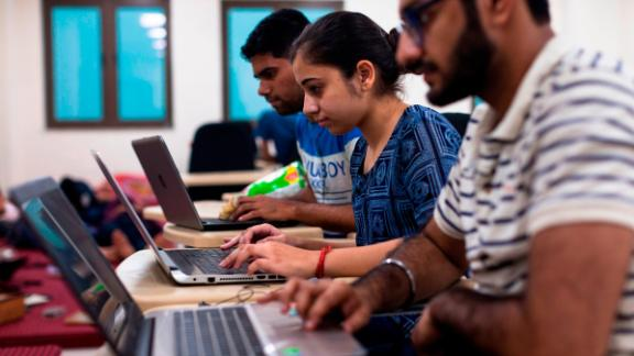 Indian undergraduate students code on their computers as they take part in HackCBS, a 24 hour event of software development also called 'hackathon', at the Shaheed Sukhdev College of Business Studies (SSCBS) in New Delhi on October 28, 2018. - Students from all over India gathered in teams to take part in a challenge to develop their ideas in the fields of Internet of Things (IoT), Artificial Intelligence (AI), Blockchain, Mobility and Education and Financial technology. (Photo by XAVIER GALIANA / AFP)        (Photo credit should read XAVIER GALIANA/AFP/Getty Images)
