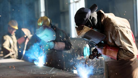 This photo taken on May 3, 2018 shows a worker cutting steel at a factory in Huaibei in China