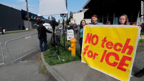 People asking Amazon.com to not sell face-recognition and other technology to federal government agencies including Immigration and Customs Enforcement, demonstrate outside Amazon.com's annual shareholders meeting, Wednesday, May 22, 2019, in Seattle. (AP Photo/Ted S. Warren)