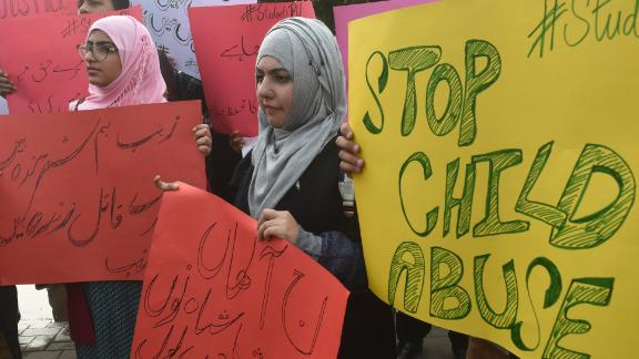 Pakistani demonstrators carry placards during a protest against the rape and murder of a child in Lahore on January 11, 2018.
