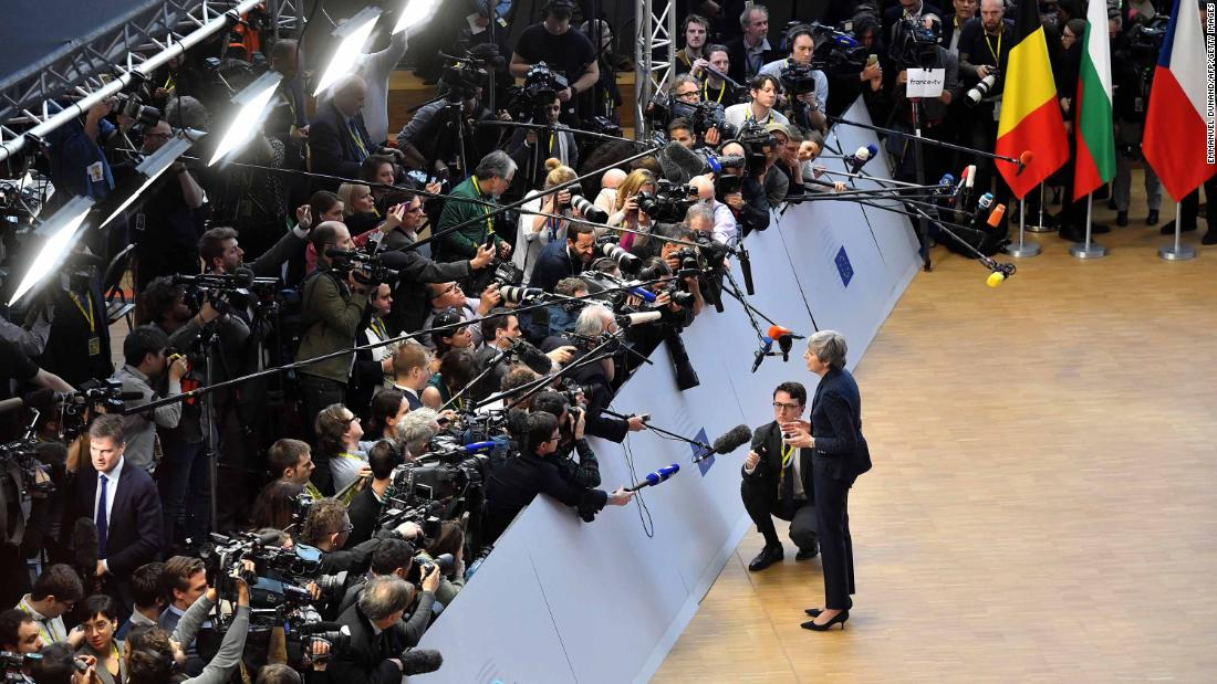 May speaks to the press in March 2019 as she arrives in Brussels, Belgium, for the first day of an EU summit focused on Brexit.