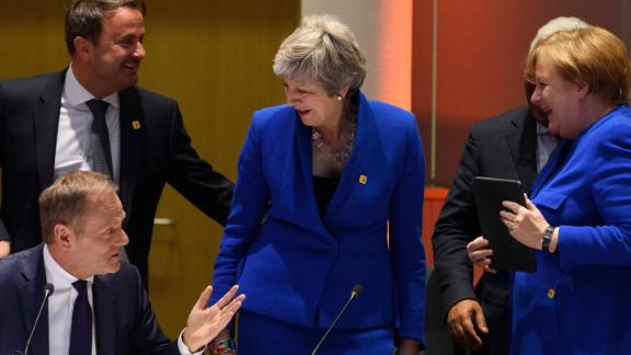 Theresa May with European leaders in Brussels. They came to disrust anything she said.