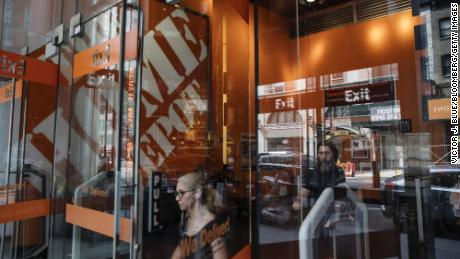 Customers exit a Home Depot Inc. store in New York, U.S., on Friday, Aug. 11, 2017. Home Depot Inc. is scheduled to release earnings figures on August 15. Photographer: Victor J. Blue/Bloomberg via Getty Images