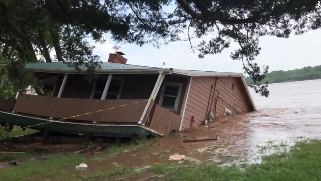 Watch house fall into river