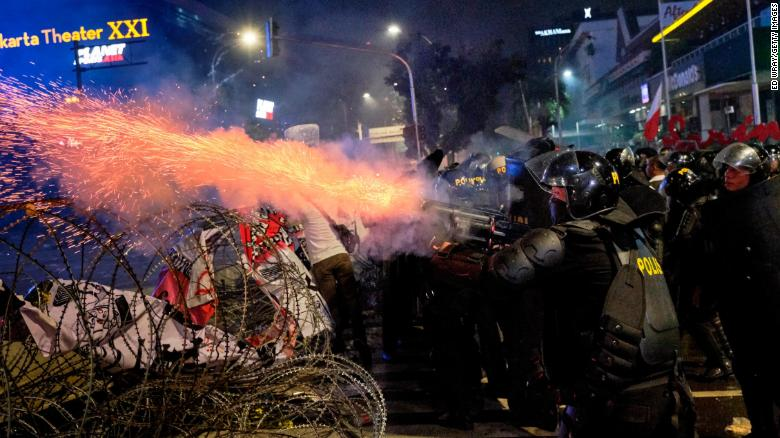 Indonesian riot policemen fire teargas at demonstrators on May 22, 2019 in Jakarta, Indonesia.