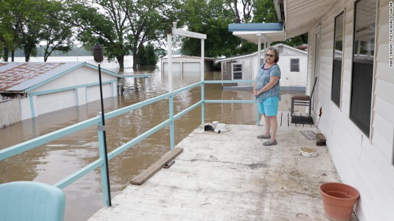 Marlene Paul watches as the Arkansas River approaches at her Webbers Falls, Oklahoma, home.