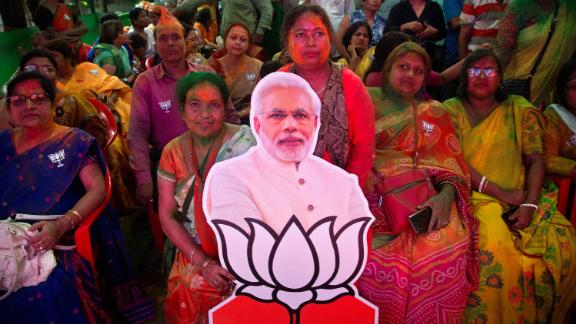 Bharatiya Janata Party (BJP) supporters celebrate with a cutout of Prime Minister Narendra Modi at their party office in Gauhati.