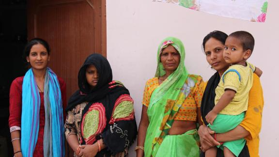 Pawan Kumar's cousin (left), wife, Nisha Devi; mother, Savitri Devi; and sister, Deep Mala at their family home in the village of Khairthal near Alwar in Rajasthan.