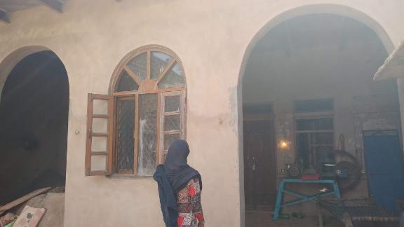 Sahila Khan, the 14-year-old daughter of Rakbar Khan, stands in front of her home in Kolgaon village in Haryana.