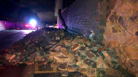 The storm leaves a wall  collapsed Thursday morning in Missouri's capital.