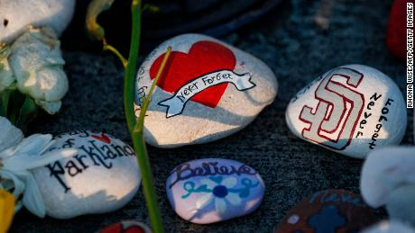 A painted rock sits outside one of the makeshift memorials at Marjory Stoneman Douglas High School in Parkland, Florida on February 27, 2018. Florida's Marjory Stoneman Douglas high school will reopen on February 28, 2018 two weeks after 17 people were killed in a shooting by former student, Nikolas Cruz, leaving 17 people dead and 15 injured on February 14, 2018. / AFP PHOTO / RHONA WISE        (Photo credit should read RHONA WISE/AFP/Getty Images)