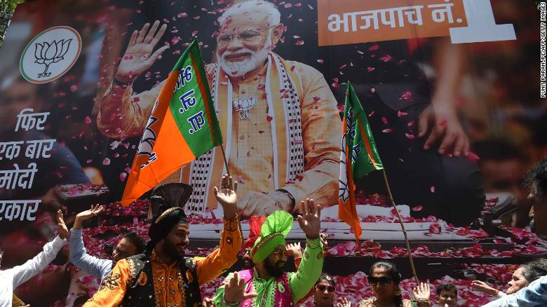 BJP supporters celebrate the election results outside the party's headquarters in Mumbai.