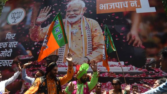 BJP supporters celebrate the election results outside the party