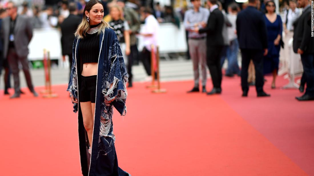 In a truly unexpected turn, Marion Cotillard wore a crop top and shorts, topped with a distressed denim kimono from Balmain.