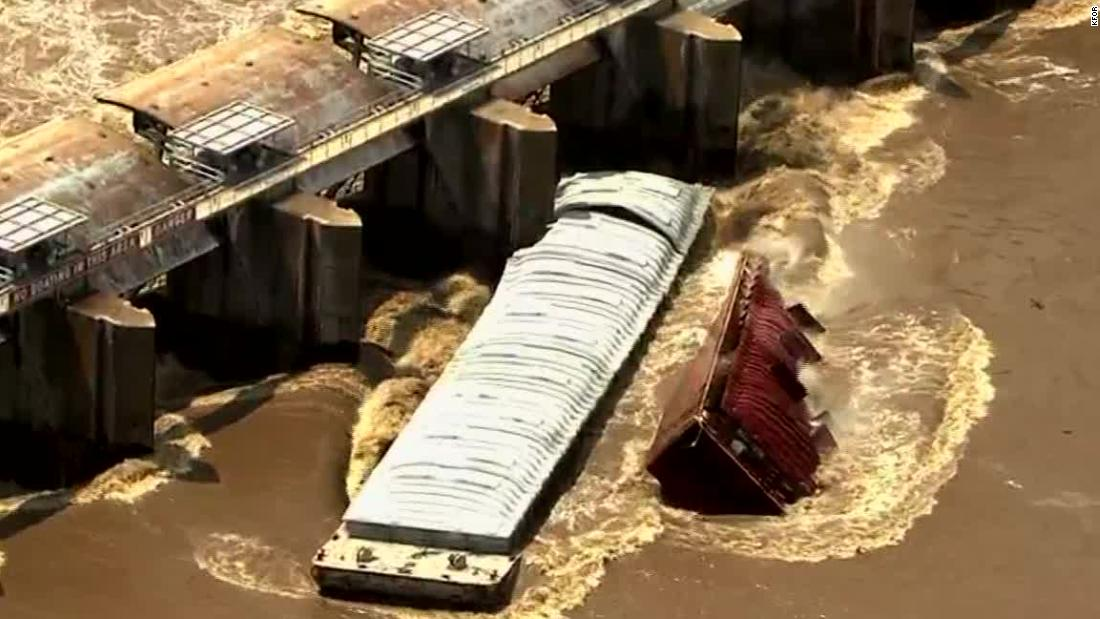 Runaway barges smash into Oklahoma dam after officials order evacuations and shut down roads