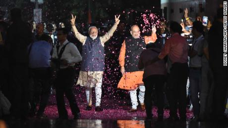 "Indian Prime Minister Narendra Modi (L) flashes the victory sign next to president of the ruling Bharatiya Janata Party (BJP) Amit Shah as they celebrate their victory in India's general elections at the party headquarters in New Delhi on May 23, 2019. - Hindu nationalist Prime Minister Narendra Modi claimed victory on May 23 in India's general election and vowed an ""inclusive"" future, with his party headed for a landslide win to crush the Gandhi dynasty's comeback hopes. (Photo by Money SHARMA / AFP)        (Photo credit should read MONEY SHARMA/AFP/Getty Images)"