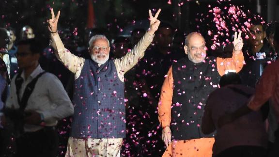 Indian Prime Minister Narendra Modi and BJP President Amit Shah celebrate the BJP