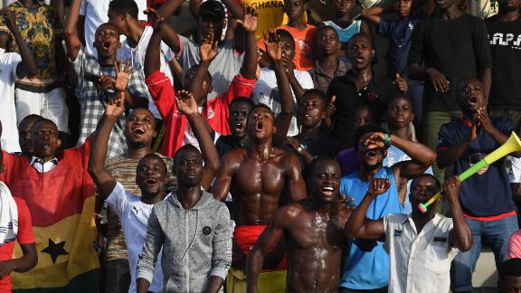 Supporters cheer during the WAFU semi-final between Ghana and Nigeria.