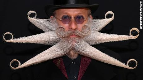 A participant of the international World Beard and Moustache Championships poses before taking part in one of the 17 categories of beard and moustache styles competing in Antwerp, Belgium May 18, 2019. ÊREUTERS/Yves Herman
