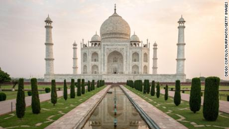 On 15 May 2019, the sun rises over the Taj Mahal, one of the Seven Wonders of the World. The Taj Mahal is a white marble mausoleum built with nearly perfect geometric architecture on the banks of the Yamuna River in the city of Agra, India. Tourists visit the attraction year-round to marvel at its scenic gardens, its fine stone work, as well as the tombs of Mumtaz Mahal and Shah Jahan.  (Photo by Diego Cupolo/NurPhoto via Getty Images)