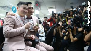 Marc and Shane register their marital status and receive new identification cards on May 24 in Taipei, Taiwan.