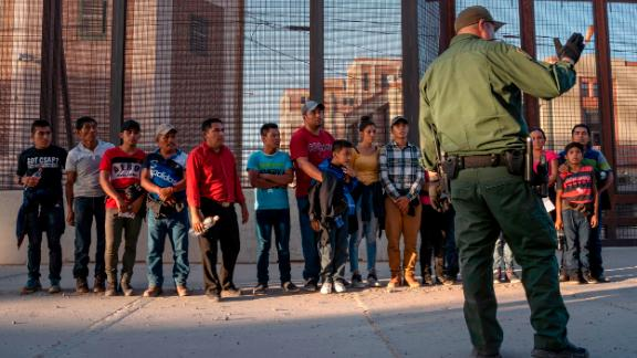 Migrants, mostly from Central America, que to board a van which will take them to a processing center, on May 16, 2019, in El Paso, Texas. - About 1,100 migrants from Central America and other countries are crossing into the El Paso border sector each day. US Customs and Border Protection Public Information Officer Frank Pino, says that Border Patrol resources and personnel are being stretched by the ongoing migrant crisis, and that the real targets of the Border Patrol are slipping through the cracks. (Photo by Paul Ratje / AFP)        (Photo credit should read PAUL RATJE/AFP/Getty Images)