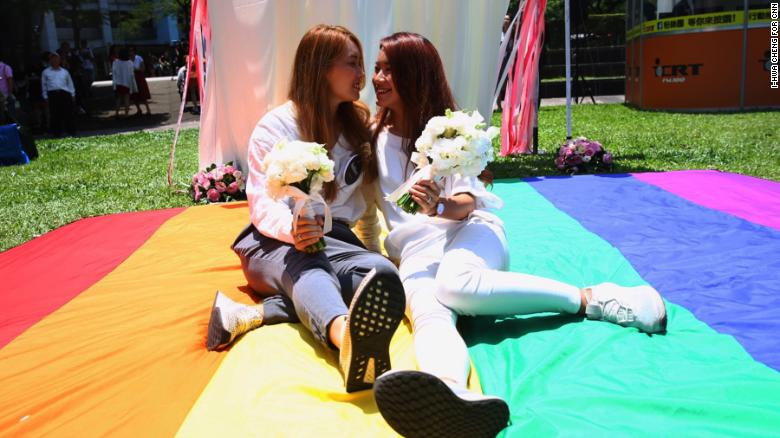 Amber Wang and Kristin Huang at a party held in Taipei to celebrate the first same-sex weddings in Asia on Friday.