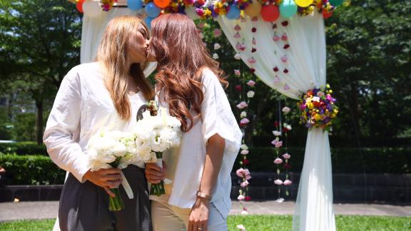 Amber Wang, left, and Kristin Huang, right, kiss during their wedding just days after Taiwan passed historical same-sex marriage law, making it the first nation in Asia.