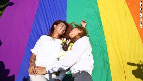 Kristin Huang (L) Amber Wang (R) laugh after their marriage as Taiwan passes historical same-sex marriage law, making it the first nation in Asia.