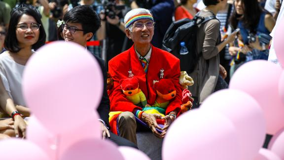Gay rights activist Chi Chia-wei shows up at the same-sex wedding party on Friday in Taipei.