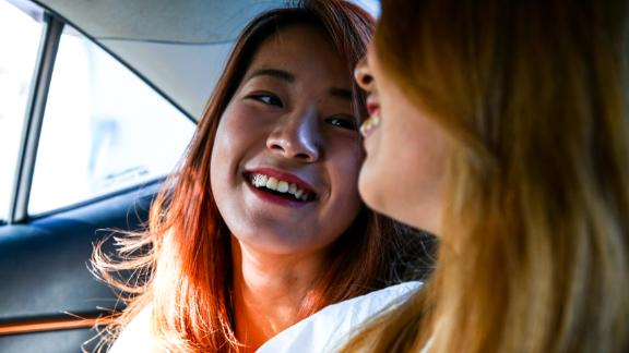 Kristin Huang, left, and Amber Wang, right, share a car ride in Taipei on Friday.