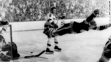 In an iconic hockey photo, Bobby Orr dives into the air after scoring against the St. Louis Blues on May 10, 1970. The goal clinched the Stanley Cup for the Boston Bruins.