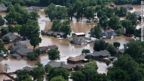 Homes are inundated with floodwater from the Arkansas River in Sand Springs, Oklahoma, a suburb of Tulsa.