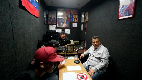 Naudy Mendez airs a pro-Maduro transmission on a colectivo controlled radio station in Caracas.