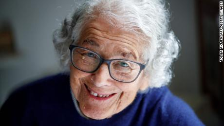 "German-born British author and illustrator Judith Kerr, poses for a photograph at her home in west London on June 12, 2018. - As British author Judith Kerr celebrates turning 95 on Thursday, her famous children's book ""The Tiger Who Came To Tea"" remains the crowning achievement of a life devoted to writing and drawing after she fled Nazi Germany. The story chronicles Sophie and her mother, having tea in the kitchen when the doorbell rings. In steps a huge tiger who devours all the food and drink before never being seen again. ""It was a bedtime story I made up for my daughter who was then three,"" said the nonagenarian, with curly grey hair and a mischievous smile, in the living room of her south west London brick house where she raised two children. (Photo by Tolga Akmen / AFP) / TO GO WITH AFP STORY by Pauline FROISSART        (Photo credit should read TOLGA AKMEN/AFP/Getty Images)"