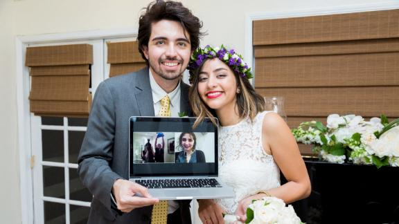 Shiva Farrokhi, founder of the in-it.com site, and her husband video chatted with friends and family abroad at their wedding in Los Angeles in 2016.