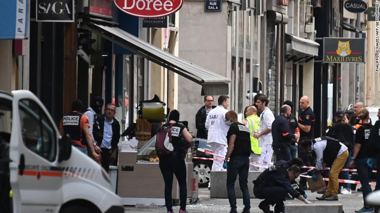 French police search for evidences in front the 'Brioche doree' after a suspected package bomb blast along a pedestrian street in the heart of Lyon, southeast France on May 24, 2019. - Several people were wounded by a suspected package bomb blast on a pedestrian street in the heart of Lyon in southeastern France, the local prosecutors' office said. The area where the explosion occurred, on the narrow strip of land between the Saone and Rhone rivers in the historic city centre, has been evacuated, according to AFP journalists at the scene. (Photo by PHILIPPE DESMAZES / AFP)        (Photo credit should read PHILIPPE DESMAZES/AFP/Getty Images)