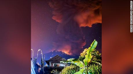 Thick smoke and glow from lava are seen as Mount Agung volcano erupts in Karangasem Regency, Bali, Indonesia, May 24, 2019, in this picture obtained from social media. Picture taken May 24, 2019, and watermarked from source. Wayan Kartika/via REUTERS THIS IMAGE HAS BEEN SUPPLIED BY A THIRD PARTY. MANDATORY CREDIT. NO RESALES. NO ARCHIVES.