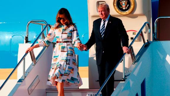 US President Donald Trump and First Lady Melania Trump disembark from Air Force One upon arrival at Haneda international airport in Tokyo on May 25, 2019. (Photo by Koji Sasahara / POOL / AFP)        (Photo credit should read KOJI SASAHARA/AFP/Getty Images)
