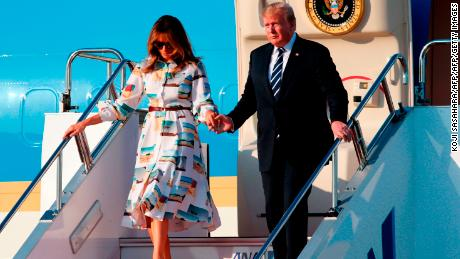 US President Donald Trump and First Lady Melania Trump disembark from Air Force One upon arrival at Haneda international airport in Tokyo on May 25, 2019. (Photo by Koji Sasahara / POOL / AFP)        (Photo credit should read KOJI SASAHARA/AFP/Getty Images)