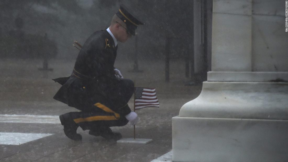 Others stood down. But this soldier braved torrential rain to honor fallen comrades