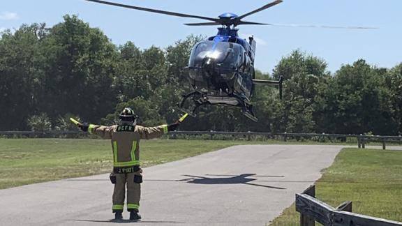 A woman is airlifted to a hospital for treatment after being bitten by an alligator.