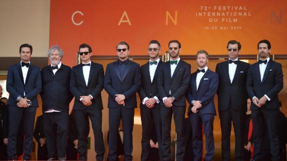 Bloom and DiCaprio met some of the drivers on the tour, including Jean-Eric Vergne (fourth from right). The Frenchman won the championship season that the feature film is based on.
