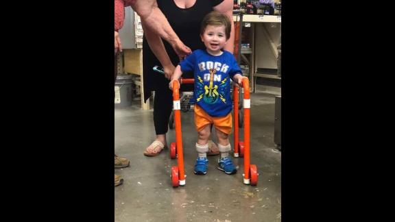 Logan looks happy with his new walker.