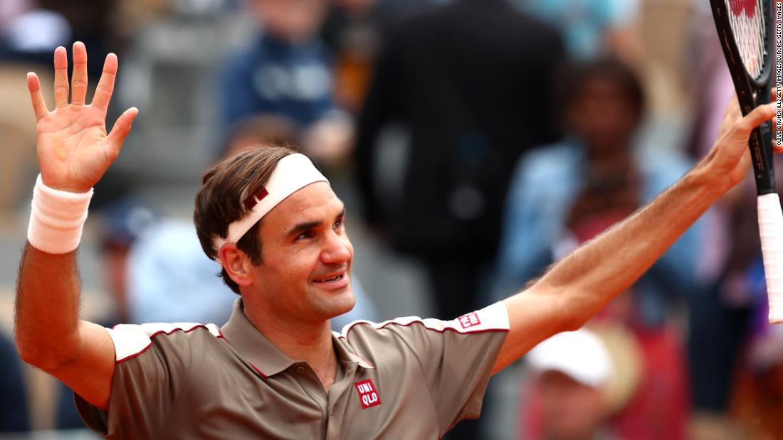 Roger Federer acknowledges the crowd after returning, and winning, at the French Open.