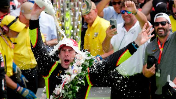 French driver Simon Pagenaud takes a traditional milk shower after his win Sunday.