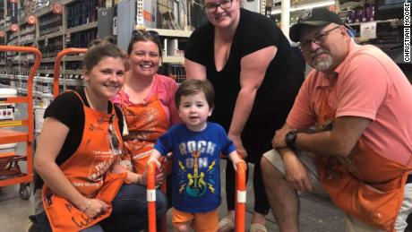 Home Depot employees build a walker for little boy