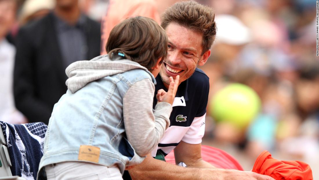 The French wildcard upset 2018 semifinalist Marco Cecchinato from two sets down, then celebrated with his son on court.