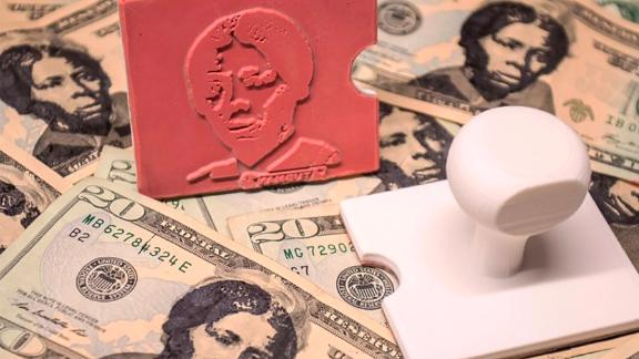 This 3-D rubber stamp allows users to superimpose Tubman's image over President Andrew Jackson's portrait.